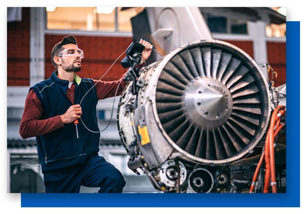 Engineer working on jet engine